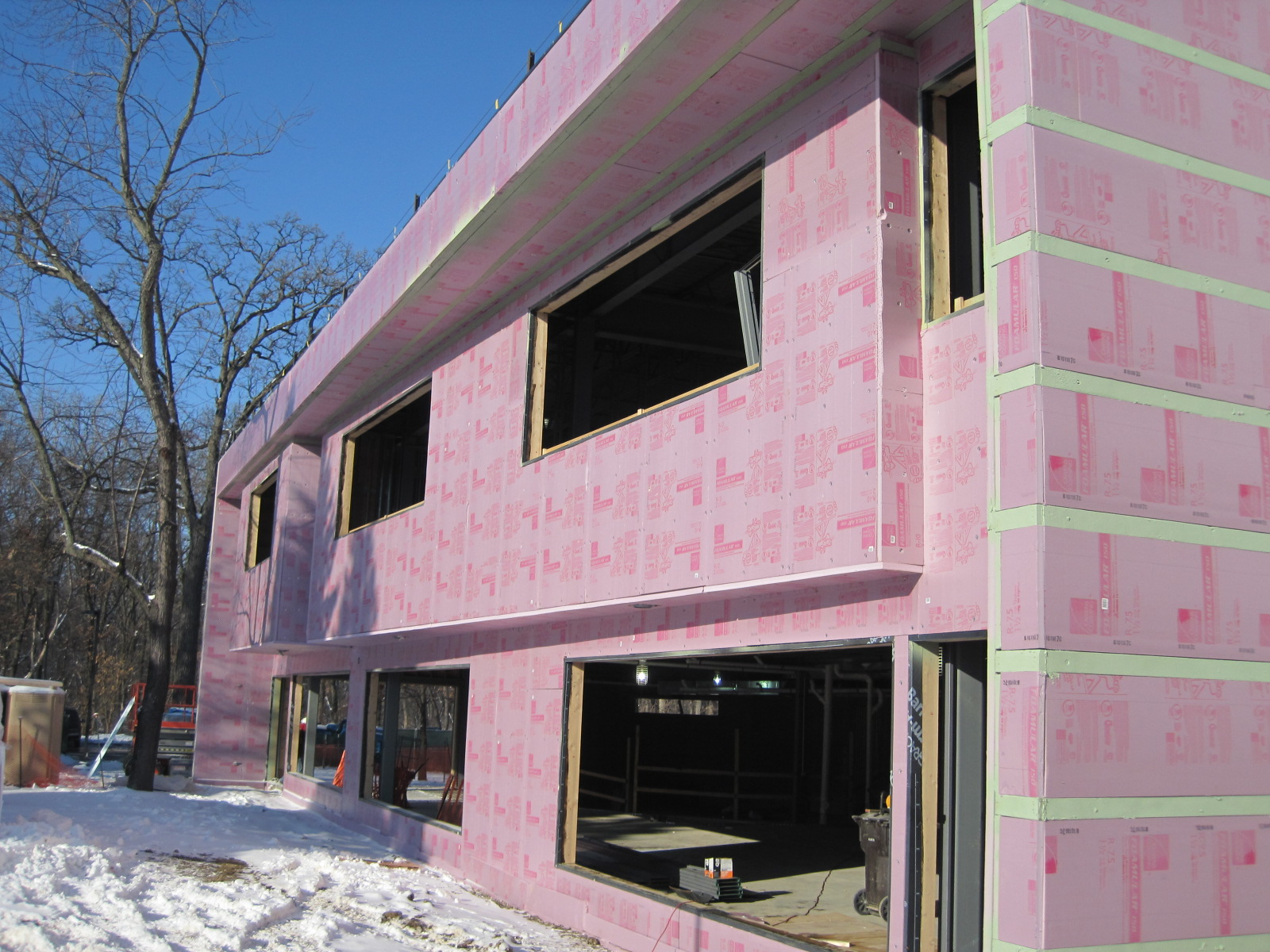 Exterior insulating sheathing wall system panelization for Exterior wall sheeting